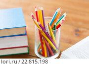 Купить «close up of crayons or color pencils and books», фото № 22815198, снято 17 марта 2016 г. (c) Syda Productions / Фотобанк Лори