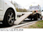 Купить «Loading broken car on a tow truck on a roadside», фото № 22815654, снято 1 мая 2015 г. (c) Andrejs Pidjass / Фотобанк Лори
