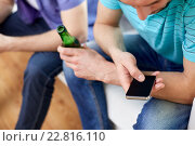Купить «close up of man with smartphone and beer at home», фото № 22816110, снято 22 марта 2014 г. (c) Syda Productions / Фотобанк Лори