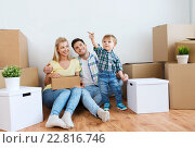 Купить «happy family with boxes moving to new home», фото № 22816746, снято 25 февраля 2016 г. (c) Syda Productions / Фотобанк Лори