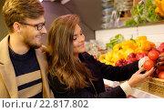 Купить «Couple choosing vegetables in a grocery store», фото № 22817802, снято 9 октября 2015 г. (c) Andrejs Pidjass / Фотобанк Лори