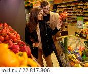 Купить «Couple choosing vegetables in a grocery store», фото № 22817806, снято 9 октября 2015 г. (c) Andrejs Pidjass / Фотобанк Лори