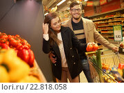 Купить «Couple choosing vegetables in a grocery store», фото № 22818058, снято 9 октября 2015 г. (c) Andrejs Pidjass / Фотобанк Лори