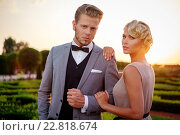 Купить «Well-dressed couple in a beautiful park», фото № 22818674, снято 11 августа 2015 г. (c) Andrejs Pidjass / Фотобанк Лори