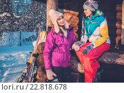 Купить «Two girlfriends spending winter holiday on mountain cottage.», фото № 22818678, снято 15 января 2016 г. (c) Andrejs Pidjass / Фотобанк Лори