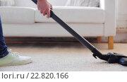 Купить «woman with vacuum cleaner cleaning carpet at home», видеоролик № 22820166, снято 17 апреля 2016 г. (c) Syda Productions / Фотобанк Лори