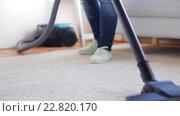 Купить «woman with vacuum cleaner cleaning carpet at home», видеоролик № 22820170, снято 17 апреля 2016 г. (c) Syda Productions / Фотобанк Лори