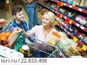 Купить «Couple choosing cheese at shop», фото № 22833498, снято 19 сентября 2018 г. (c) Яков Филимонов / Фотобанк Лори
