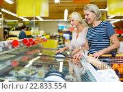 Купить «Female customers near display with frozen food», фото № 22833554, снято 18 января 2019 г. (c) Яков Филимонов / Фотобанк Лори