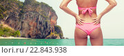Купить «close up of young woman buttocks in pink bikini», фото № 22843938, снято 14 апреля 2015 г. (c) Syda Productions / Фотобанк Лори