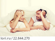 Купить «happy couple lying in bed and talking at home», фото № 22844270, снято 6 июня 2015 г. (c) Syda Productions / Фотобанк Лори