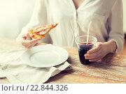 Купить «close up of woman with pizza and cola drink», фото № 22844326, снято 21 мая 2015 г. (c) Syda Productions / Фотобанк Лори