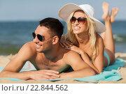 Купить «happy couple in swimwear lying on summer beach», фото № 22844562, снято 11 августа 2015 г. (c) Syda Productions / Фотобанк Лори