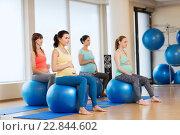 Купить «happy pregnant women exercising on fitball in gym», фото № 22844602, снято 5 марта 2016 г. (c) Syda Productions / Фотобанк Лори