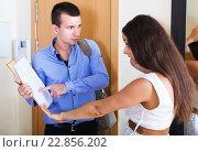 Купить «Collector asking householder for money», фото № 22856202, снято 16 января 2019 г. (c) Яков Филимонов / Фотобанк Лори