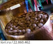 Купить «Chocolate beads filled in cacao close up», фото № 22860462, снято 10 декабря 2018 г. (c) Яков Филимонов / Фотобанк Лори
