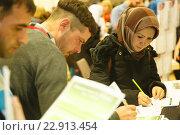 Купить «Berlin, Germany, Job Market for refugee people in the Hotel Estrel», фото № 22913454, снято 29 февраля 2016 г. (c) Caro Photoagency / Фотобанк Лори
