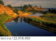 Купить «Evening light on granites and white pine at mouth of Chikanishing Creek in Georgian Bay, Killarney Provincial Park, Ontario, Canada.», фото № 22918450, снято 31 мая 2020 г. (c) age Fotostock / Фотобанк Лори