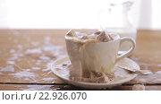 Купить «coffee and sugar falling to cup on table», видеоролик № 22926070, снято 15 апреля 2016 г. (c) Syda Productions / Фотобанк Лори