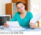 Купить «Melancholy woman working with documents», фото № 22938702, снято 20 февраля 2020 г. (c) Яков Филимонов / Фотобанк Лори