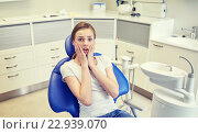 Купить «scared and terrified patient girl at dental clinic», фото № 22939070, снято 23 мая 2015 г. (c) Syda Productions / Фотобанк Лори