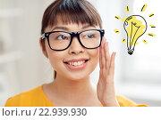 Купить «asian woman in glasses with light bulb doodle», фото № 22939930, снято 9 марта 2016 г. (c) Syda Productions / Фотобанк Лори