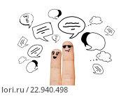 Купить «close up of two fingers with communication clouds», фото № 22940498, снято 2 марта 2016 г. (c) Syda Productions / Фотобанк Лори