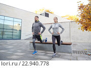 Купить «couple doing lunge exercise on city street», фото № 22940778, снято 17 октября 2015 г. (c) Syda Productions / Фотобанк Лори