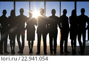 business people silhouettes over office background. Стоковое фото, фотограф Syda Productions / Фотобанк Лори