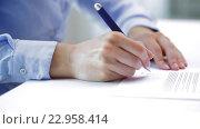 Купить «businesswoman with pen signing contract document», видеоролик № 22958414, снято 14 мая 2016 г. (c) Syda Productions / Фотобанк Лори
