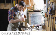 Купить «carpenter working with plane and wood at workshop», видеоролик № 22978482, снято 21 мая 2016 г. (c) Syda Productions / Фотобанк Лори