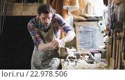 Купить «carpenter with chisel working at workshop», видеоролик № 22978506, снято 21 мая 2016 г. (c) Syda Productions / Фотобанк Лори