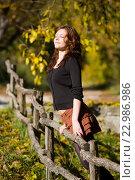 Smelling fresh air in Autumn young woman. Стоковое фото, фотограф Emil Pozar / age Fotostock / Фотобанк Лори