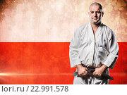 Купить «Composite image of fighter tightening karate belt», фото № 22991578, снято 18 августа 2019 г. (c) Wavebreak Media / Фотобанк Лори