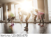 Купить «group of people exercising with barbell in gym», фото № 23003670, снято 5 апреля 2015 г. (c) Syda Productions / Фотобанк Лори