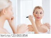 Купить «woman with makeup brush and powder at bathroom», фото № 23003854, снято 13 февраля 2016 г. (c) Syda Productions / Фотобанк Лори