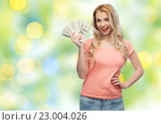 Купить «happy young woman with usa dollar cash money», фото № 23004026, снято 30 апреля 2016 г. (c) Syda Productions / Фотобанк Лори