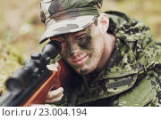 Купить «soldier or hunter shooting with gun in forest», фото № 23004194, снято 14 августа 2014 г. (c) Syda Productions / Фотобанк Лори