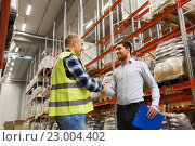 Купить «worker and businessmen with clipboard at warehouse», фото № 23004402, снято 9 декабря 2015 г. (c) Syda Productions / Фотобанк Лори