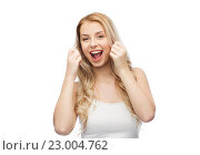 Купить «happy young woman with dental floss cleaning teeth», фото № 23004762, снято 30 апреля 2016 г. (c) Syda Productions / Фотобанк Лори