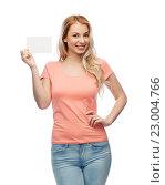 Купить «happy woman or teen girl with blank white paper», фото № 23004766, снято 30 апреля 2016 г. (c) Syda Productions / Фотобанк Лори