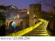 Купить «evening view of medieval bridge at Besalu. Catalonia», фото № 23006254, снято 15 октября 2018 г. (c) Яков Филимонов / Фотобанк Лори