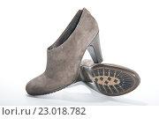 Купить «Пара женских ботильонов на каблуках на белом фоне», фото № 23018782, снято 18 августа 2010 г. (c) Olesya Tseytlin / Фотобанк Лори