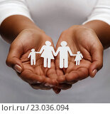 african american female hands with paper family. Стоковое фото, фотограф Syda Productions / Фотобанк Лори