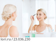 Купить «woman with brush doing eyebrow makeup at bathroom», фото № 23036230, снято 13 февраля 2016 г. (c) Syda Productions / Фотобанк Лори