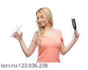 Купить «young woman with scissors and hairbrush», фото № 23036238, снято 30 апреля 2016 г. (c) Syda Productions / Фотобанк Лори