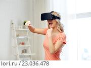 Купить «woman in virtual reality headset or 3d glasses», фото № 23036478, снято 30 апреля 2016 г. (c) Syda Productions / Фотобанк Лори