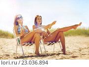 Купить «girls with drinks on the beach chairs», фото № 23036894, снято 11 июля 2013 г. (c) Syda Productions / Фотобанк Лори
