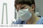 Лечение кариеса. Человек посещает стоматолога. (2016 год). Редакционное видео, видеограф ActionStore / Фотобанк Лори