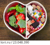 Купить «Healthy or Unhealthy food.», фото № 23048390, снято 19 апреля 2016 г. (c) Tatjana Baibakova / Фотобанк Лори